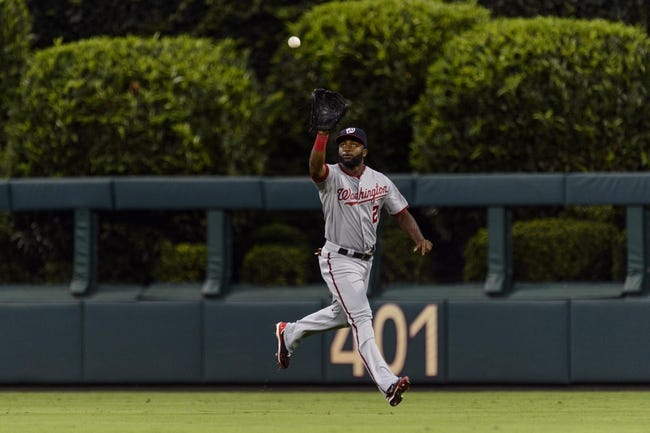 Sep 3, 2013; Philadelphia, PA, USA; Washington Nationals center fielder Denard Span (2) makes a catch during the first inning against the Philadelphia Phillies at Citizens Bank Park. The Nationals defeated the Phillies 9-6. Mandatory Credit: Howard Smith-USA TODAY Sports