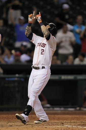 Sep 3, 2013; Houston, TX, USA; Houston Astros center fielder Brandon Barnes (2) celebrates hitting a three-run home run against the Minnesota Twins to tie the game during the ninth inning at Minute Maid Park. Mandatory Credit: Thomas Campbell-USA TODAY Sports
