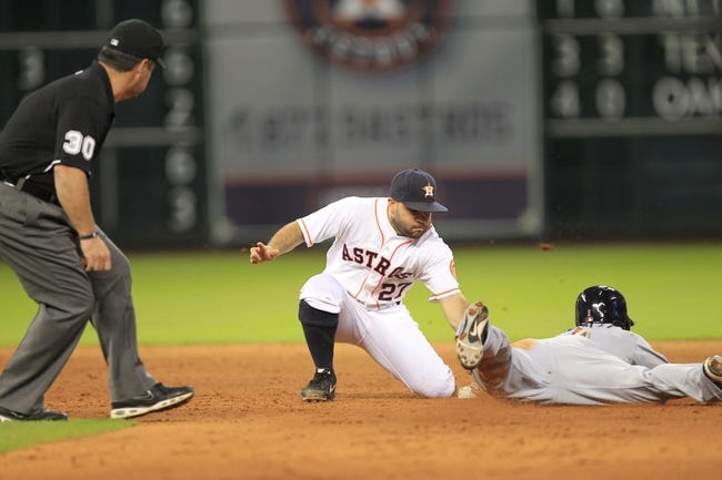 Sep 3, 2013; Houston, TX, USA; Houston Astros second baseman Jose Altuve (27) tags out Minnesota Twins left fielder Alex Presley (1) on a steal attempt during the tenth inning at Minute Maid Park. Mandatory Credit: Thomas Campbell-USA TODAY Sports