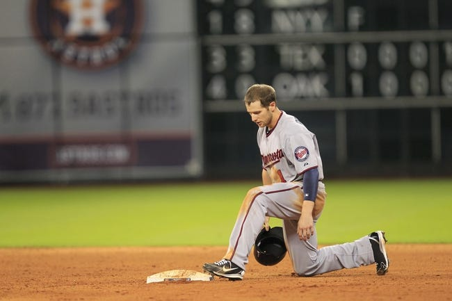 Sep 3, 2013; Houston, TX, USA; Minnesota Twins left fielder Alex Presley (1) reacts to getting caught stealing against the Houston Astros during the tenth inning at Minute Maid Park. Mandatory Credit: Thomas Campbell-USA TODAY Sports