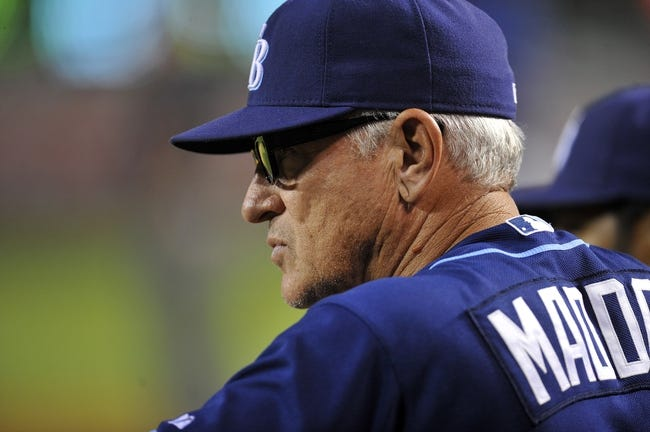 September 3, 2013; Anaheim, CA, USA; Tampa Bay Rays manager Joe Maddon (70) watches game action during the fourth inning against the Los Angeles Angels at Angel Stadium of Anaheim. Mandatory Credit: Gary A. Vasquez-USA TODAY Sports