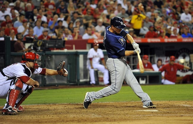 September 3, 2013; Anaheim, CA, USA; Tampa Bay Rays second baseman Ben Zobrist (18) hits a two run RBI double during the fourth inning against the Los Angeles Angels at Angel Stadium of Anaheim. Mandatory Credit: Gary A. Vasquez-USA TODAY Sports
