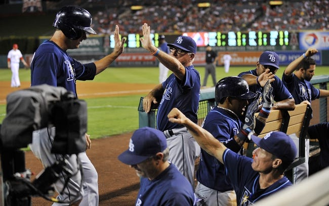 September 3, 2013; Anaheim, CA, USA; Tampa Bay Rays left fielder Kelly Johnson (2) is congratulated after scoring a run in the fourth inning against the Los Angeles Angels at Angel Stadium of Anaheim. Mandatory Credit: Gary A. Vasquez-USA TODAY Sports
