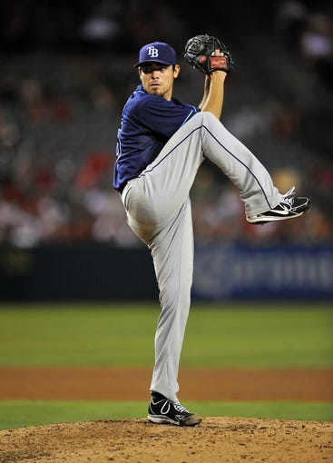 September 3, 2013; Anaheim, CA, USA; Tampa Bay Rays starting pitcher Matt Moore (55) pitches during the fourth inning against the Los Angeles Angels at Angel Stadium of Anaheim. Mandatory Credit: Gary A. Vasquez-USA TODAY Sports