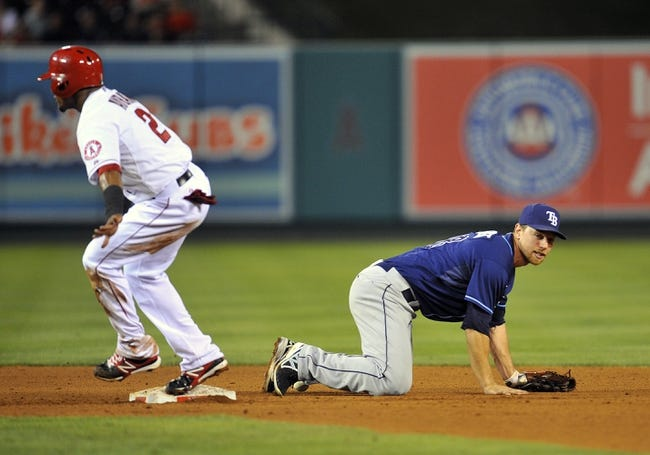 September 3, 2013; Anaheim, CA, USA; Los Angeles Angels shortstop Erick Aybar (2) is safe at second base after Tampa Bay Rays second baseman Ben Zobrist (18) fails to turn a double play in the fourth inning at Angel Stadium of Anaheim. Mandatory Credit: Gary A. Vasquez-USA TODAY Sports