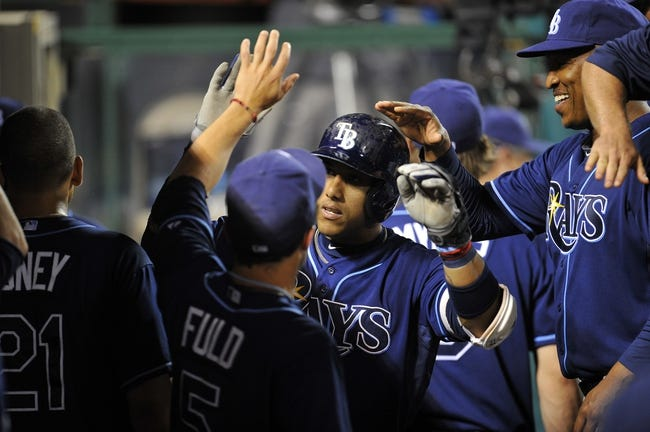 September 3, 2013; Anaheim, CA, USA; Tampa Bay Rays shortstop Yunel Escobar (11) is congratulated after hitting a solo home run in the fifth inning against the Los Angeles Angels at Angel Stadium of Anaheim. Mandatory Credit: Gary A. Vasquez-USA TODAY Sports