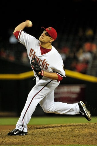 Sept 3, 2013; Phoenix, AZ, USA; Arizona Diamondbacks relief pitcher David Hernandez (30) throws during the seventh inning against the Toronto Blue Jays at Chase Field. Mandatory Credit: Matt Kartozian-USA TODAY Sports