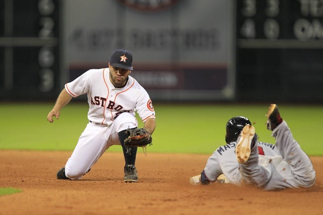Sep 3, 2013; Houston, TX, USA; Minnesota Twins center fielder Darin Mastroianni (19) beats the throw to Houston Astros second baseman Jose Altuve (27) after tagging up on a fly ball during the eleventh inning at Minute Maid Park. Mandatory Credit: Thomas Campbell-USA TODAY Sports