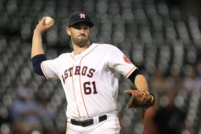 Sep 3, 2013; Houston, TX, USA; Houston Astros relief pitcher Joshua Zeid (61) throws out a runner against the Minnesota Twins during the eleventh inning at Minute Maid Park. Mandatory Credit: Thomas Campbell-USA TODAY Sports