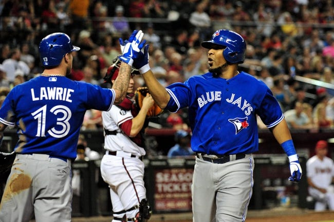 Sept 3, 2013; Phoenix, AZ, USA; Toronto Blue Jays first baseman Edwin Encarnacion (10) celebrates with third baseman Brett Lawrie (13) after hitting a solo home run during the eighth inning against the Arizona Diamondbacks at Chase Field. Mandatory Credit: Matt Kartozian-USA TODAY Sports