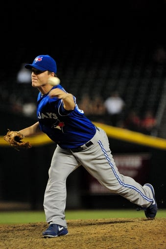 Sept 3, 2013; Phoenix, AZ, USA; Toronto Blue Jays relief pitcher Aaron Loup (62) throws during the ninth inning against the Arizona Diamondbacks at Chase Field. Mandatory Credit: Matt Kartozian-USA TODAY Sports
