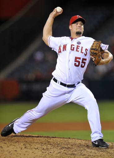 September 3, 2013; Anaheim, CA, USA; Los Angeles Angels starting pitcher Joe Blanton (55) pitches during the seventh inning against the Tampa Bay Rays at Angel Stadium of Anaheim. Mandatory Credit: Gary A. Vasquez-USA TODAY Sports