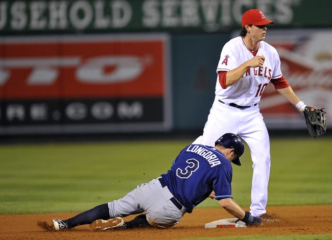 September 3, 2013; Anaheim, CA, USA; Tampa Bay Rays third baseman Evan Longoria (3) is out at second after Los Angeles Angels second baseman Grant Green (10) throws to first in the eighth inning at Angel Stadium of Anaheim. Mandatory Credit: Gary A. Vasquez-USA TODAY Sports