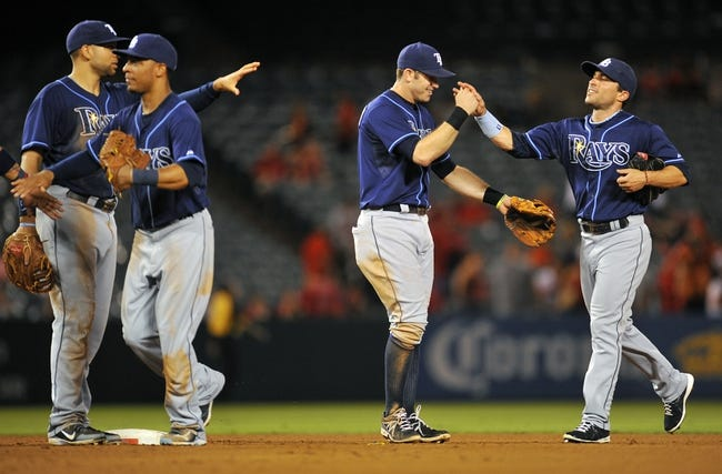 September 3, 2013; Anaheim, CA, USA; Tampa Bay Rays celebrate their 7-1 victory against the Los Angeles Angels at Angel Stadium of Anaheim. Mandatory Credit: Gary A. Vasquez-USA TODAY Sports