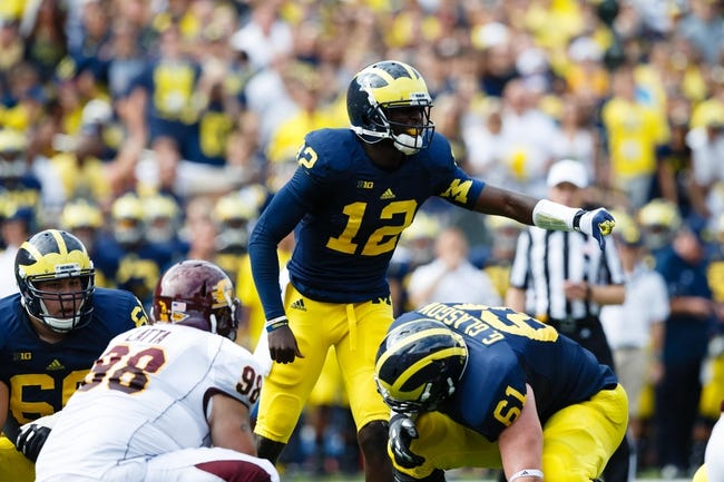 Aug 31, 2013; Ann Arbor, MI, USA; Michigan Wolverines quarterback Devin Gardner (12) calls a play against the Central Michigan Chippewas at Michigan Stadium. Mandatory Credit: Rick Osentoski-USA TODAY Sports