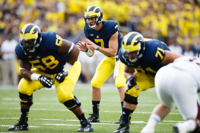 Aug 31, 2013; Ann Arbor, MI, USA; Michigan Wolverines quarterback Shane Morris (7) gets set to run a play against the Central Michigan Chippewas at Michigan Stadium. Mandatory Credit: Rick Osentoski-USA TODAY Sports