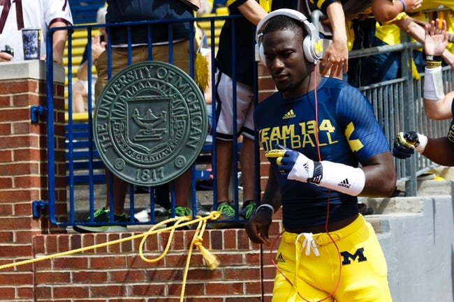 Aug 31, 2013; Ann Arbor, MI, USA; Michigan Wolverines quarterback Devin Gardner (12) before the game against the Central Michigan Chippewas at Michigan Stadium. Mandatory Credit: Rick Osentoski-USA TODAY Sports