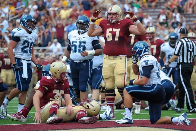 Aug 31, 2013; Boston, MA, USA; Boston College Eagles offensive linesman Seth Betancourt (67) reacts after a play during the first half against the Villanova Wildcats at Alumni Stadium. Mandatory Credit: Bob DeChiara-USA TODAY Sports