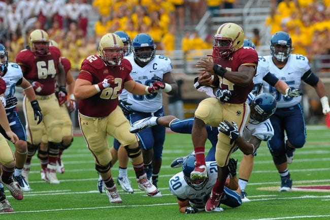 Aug 31, 2013; Boston, MA, USA; Boston College Eagles running back Andre Williams (44) runs the ball against the Villanova Wildcats during the first half at Alumni Stadium. Mandatory Credit: Bob DeChiara-USA TODAY Sports