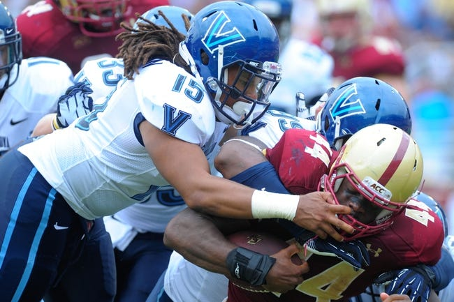 Aug 31, 2013; Boston, MA, USA; Villanova Wildcats linebacker Joey Harmon (15) grabs the face mask of Boston College Eagles running back Andre Williams (44) during the first half at Alumni Stadium. Mandatory Credit: Bob DeChiara-USA TODAY Sports