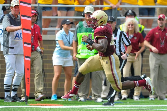 Aug 31, 2013; Boston, MA, USA; Boston College Eagles running back Andre Williams (44) runs for a touchdown during the second half against the Villanova Wildcats at Alumni Stadium. Mandatory Credit: Bob DeChiara-USA TODAY Sports