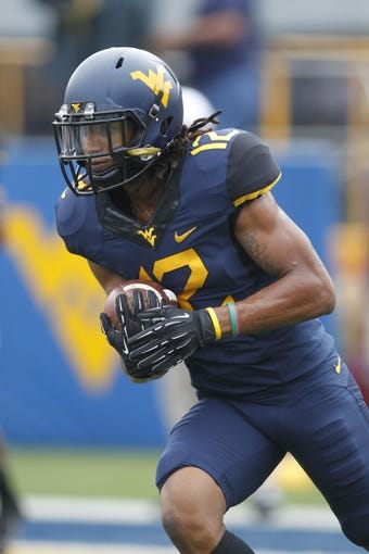 Aug 31, 2013; Morgantown, WV, USA; West Virginia Mountaineers wide receiver Ronald Carswell (12) on the field before playing the William & Mary Tribe at Milan Puskar Stadium. The West Virginia Mountaineers won 24-17. Mandatory Credit: Charles LeClaire-USA TODAY Sports