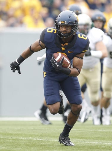 Aug 31, 2013; Morgantown, WV, USA; West Virginia Mountaineers wide receiver Daikiel Shorts (6) runs after a pass reception against the William & Mary Tribe during the first quarter at Milan Puskar Stadium. The West Virginia Mountaineers won 24-17. Mandatory Credit: Charles LeClaire-USA TODAY Sports