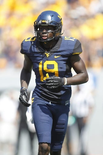 Aug 31, 2013; Morgantown, WV, USA; West Virginia Mountaineers cornerback Brandon Napoleon (19) on the field against the William & Mary Tribe during the fourth quarter at Milan Puskar Stadium. The West Virginia Mountaineers won 24-17. Mandatory Credit: Charles LeClaire-USA TODAY Sports