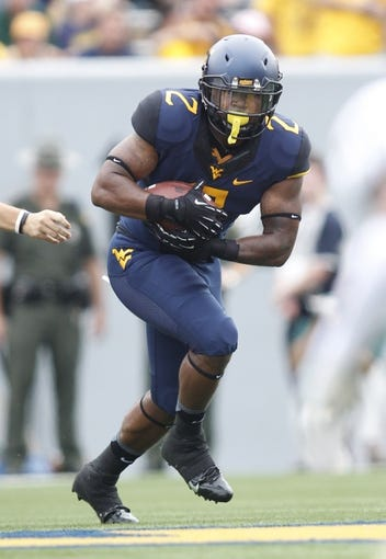Aug 31, 2013; Morgantown, WV, USA; West Virginia Mountaineers running back Dreamius Smith (2) carries the ball against the William & Mary Tribe during the first quarter at Milan Puskar Stadium. The West Virginia Mountaineers won 24-17. Mandatory Credit: Charles LeClaire-USA TODAY Sports
