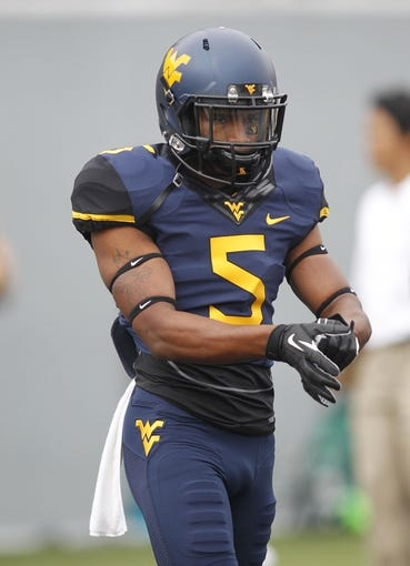 Aug 31, 2013; Morgantown, WV, USA; West Virginia Mountaineers wide receiver Mario Alford (5) on the field before playing the William & Mary Tribe at Milan Puskar Stadium. The West Virginia Mountaineers won 24-17. Mandatory Credit: Charles LeClaire-USA TODAY Sports