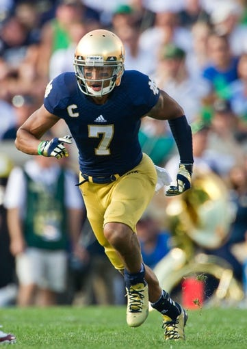 Aug 31, 2013; South Bend, IN, USA; Notre Dame Fighting Irish wide receiver TJ Jones (7) runs a route in the third quarter against the Temple Owls at Notre Dame Stadium. Notre Dame won 28-6. Mandatory Credit: Matt Cashore-USA TODAY Sports
