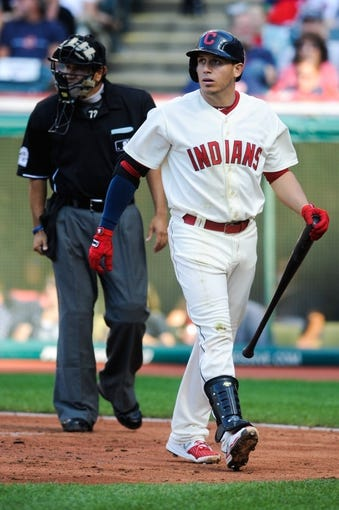Sep 2, 2013; Cleveland, OH, USA; Cleveland Indians shortstop Asdrubal Cabrera (13) walks off the field after striking out against the Baltimore Orioles at Progressive Field. Mandatory Credit: Ken Blaze-USA TODAY Sports