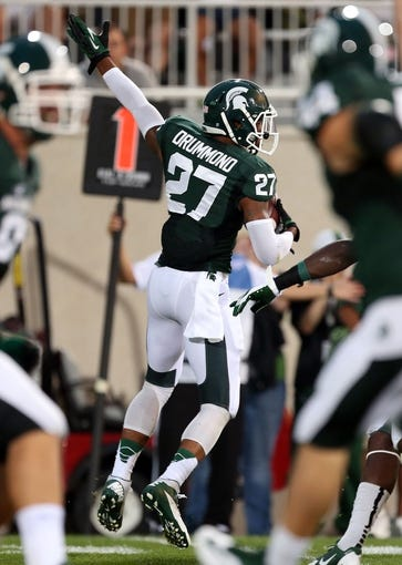 Aug 30, 2013; East Lansing, MI, USA; Michigan State Spartans safety Kurtis Drummond (27) celebrates an interception against the Western Michigan Broncos during 2nd  half of a game at Spartan Stadium. MSU won 26-13.   Mandatory Credit: Mike Carter-USA TODAY Sports