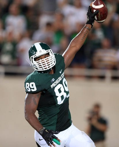 Aug 30, 2013; East Lansing, MI, USA; Michigan State Spartans defensive end Shilique Calhoun (89) scores a touchdown on fumble recovery against the Western Michigan Broncos during 2nd  half of a game at Spartan Stadium. MSU won 26-13.   Mandatory Credit: Mike Carter-USA TODAY Sports