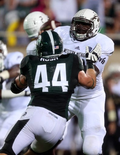 Aug 30, 2013; East Lansing, MI, USA; Michigan State Spartans defensive end Marcus Rush (44) rushes gainst the  Western Michigan Broncos during 1st half of a game at Spartan Stadium.   Mandatory Credit: Mike Carter-USA TODAY Sports