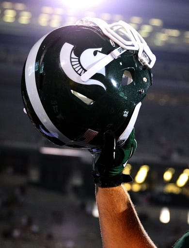 Aug 30, 2013; East Lansing, MI, USA;  Close up view of Michigan State Spartans helmet after a game at Spartan Stadium.   Mandatory Credit: Mike Carter-USA TODAY Sports