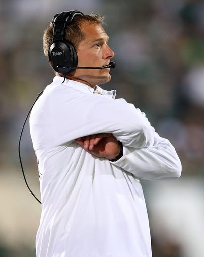 Aug 30, 2013; East Lansing, MI, USA; Western Michigan Broncos head coach P.J. Fleck walks the sideline against the Michigan State Spartans during 2nd  half of a game at Spartan Stadium. MSU won 26-13.   Mandatory Credit: Mike Carter-USA TODAY Sports
