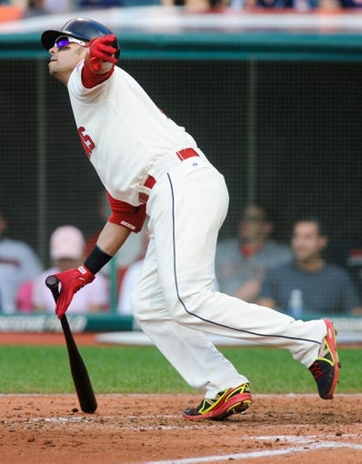 Sep 2, 2013; Cleveland, OH, USA; Cleveland Indians first baseman Nick Swisher (33) watches a fly out against the Baltimore Orioles at Progressive Field. Mandatory Credit: Ken Blaze-USA TODAY Sports