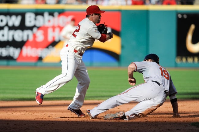 Sep 2, 2013; Cleveland, OH, USA; Cleveland Indians second baseman Jason Kipnis (22) forces out Baltimore Orioles first baseman Chris Davis (19) during the fifth inning at Progressive Field. Mandatory Credit: Ken Blaze-USA TODAY Sports