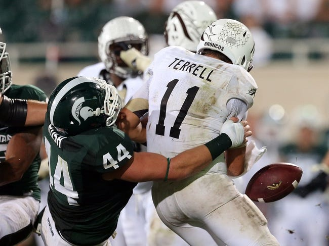 Aug 30, 2013; East Lansing, MI, USA; Western Michigan Broncos quarterback Zach Terrell (11) is sacked by Michigan State Spartans defensive end Marcus Rush (44) during 2nd  half of a game at Spartan Stadium. MSU won 26-13.   Mandatory Credit: Mike Carter-USA TODAY Sports