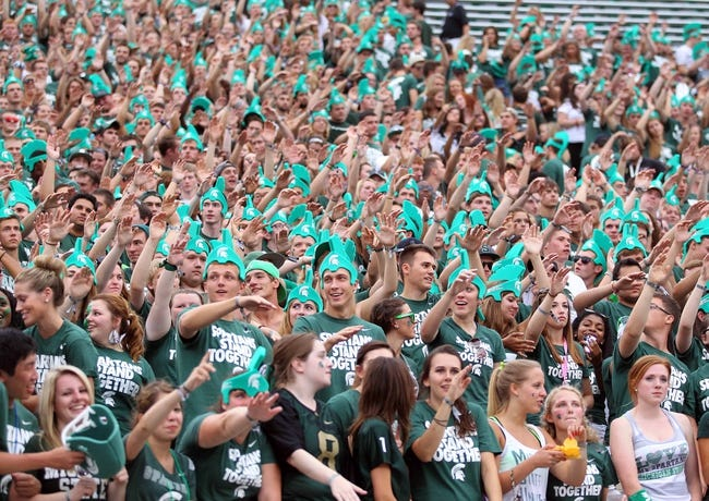 Aug 30, 2013; East Lansing, MI, USA; Michigan State Spartans student section cheers on the Spartans prior to a game against the Western Michigan Broncos at Spartan Stadium.   Mandatory Credit: Mike Carter-USA TODAY Sports