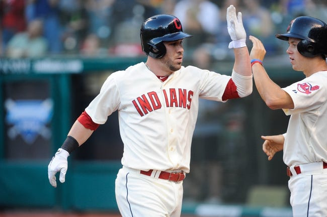 Sep 2, 2013; Cleveland, OH, USA; Cleveland Indians second baseman Jason Kipnis (22) is congratulated after hitting a home run against the Baltimore Orioles at Progressive Field. Mandatory Credit: Ken Blaze-USA TODAY Sports