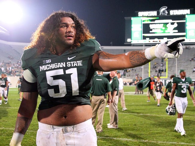 Aug 30, 2013; East Lansing, MI, USA; Michigan State Spartans offensive tackle Fou Fonoti (51) walks off the field after a game against the Western Michigan Broncos  at Spartan Stadium.   Mandatory Credit: Mike Carter-USA TODAY Sports