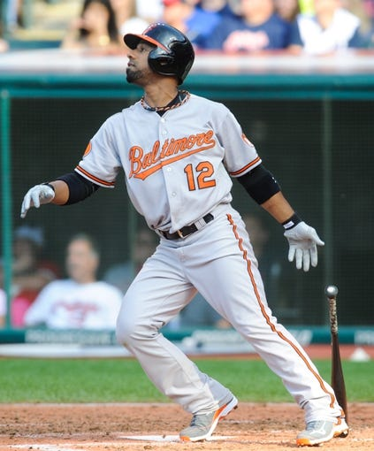 Sep 2, 2013; Cleveland, OH, USA; Baltimore Orioles second baseman Alexi Casilla (12) at bat against the Cleveland Indians at Progressive Field. Mandatory Credit: Ken Blaze-USA TODAY Sports