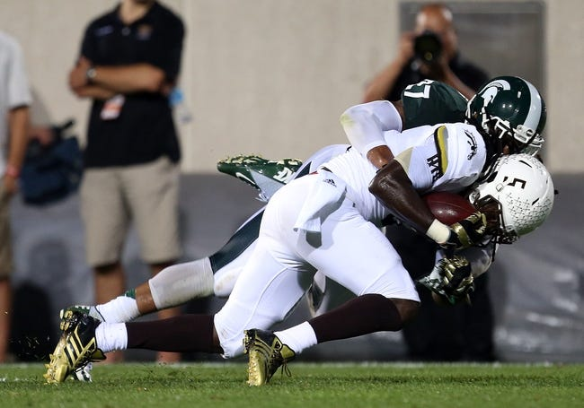 Aug 30, 2013; East Lansing, MI, USA; Western Michigan Broncos wide receiver Timmy Keith (5) is tackled by Michigan State Spartans safety Kurtis Drummond (27) during 1st half of a game at Spartan Stadium.   Mandatory Credit: Mike Carter-USA TODAY Sports