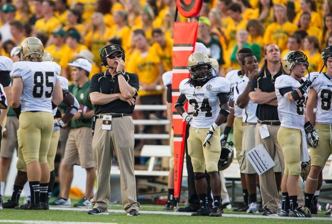 Aug 31, 2013; Waco, TX, USA; Wofford Terriers head coach Mike Ayers watches his team take on the Baylor Bears during the game at Floyd Casey Stadium. The Bears defeated the Terriers 69-3. Mandatory Credit: Jerome Miron-USA TODAY Sports