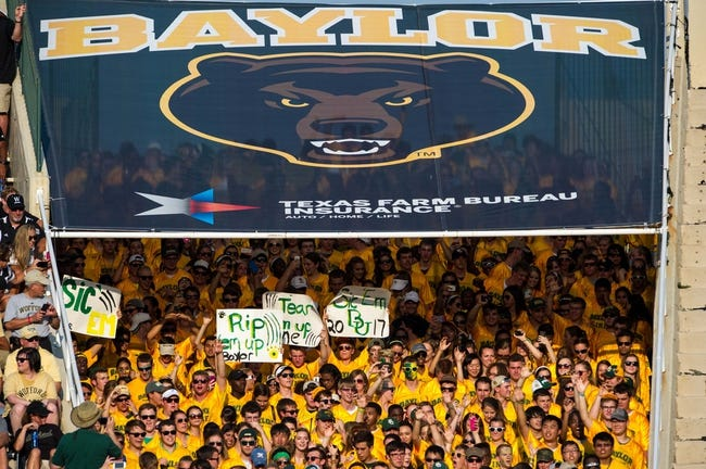 Aug 31, 2013; Waco, TX, USA; The Baylor Bears students and fans walk on to the field before the game between the Bears and the Wofford Terriers at Floyd Casey Stadium. The Bears defeated the Terriers 69-3. Mandatory Credit: Jerome Miron-USA TODAY Sports