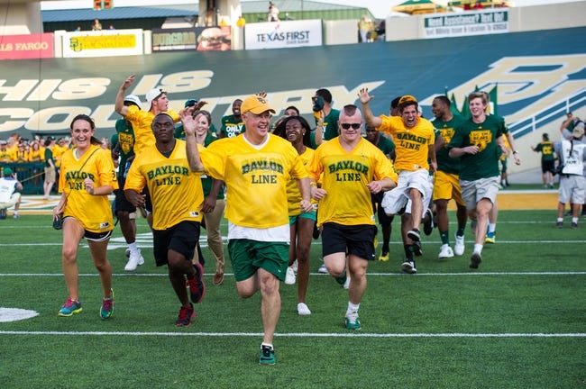 Aug 31, 2013; Waco, TX, USA; Baylor university president Ken Starr leads the Baylor students on to the field before the game between the Baylor Bears and the Wofford Terriers at Floyd Casey Stadium. The Bears defeated the Terriers 69-3. Mandatory Credit: Jerome Miron-USA TODAY Sports