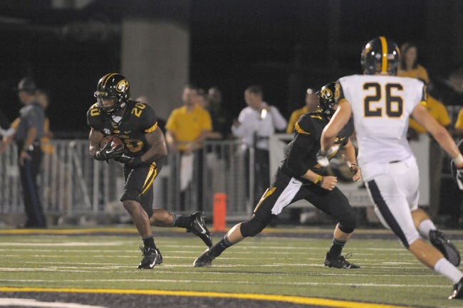 Aug 31, 2013; Columbia, MO, USA; Missouri Tigers running back Henry Josey (20) runs the ball during the second half of the game against the Murray State Racers at Faurot Field. Missouri won 58-14. Mandatory Credit: Denny Medley-USA TODAY Sports