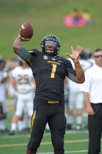 Aug 31, 2013; Columbia, MO, USA; Missouri Tigers quarterback James Franklin (1) warms up before the game against the Murray State Racers at Faurot Field. Missouri won 58-14. Mandatory Credit: Denny Medley-USA TODAY Sports